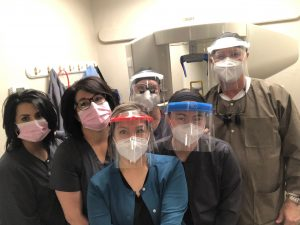 dental team with covid-19 PPE